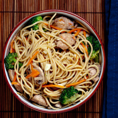 Chicken Chow Mein with Vegetables and chopsticks