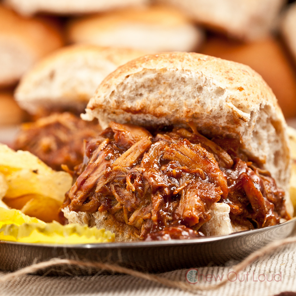 Smoky BBQ Pulled Chicken in bun with potato chips and pickles