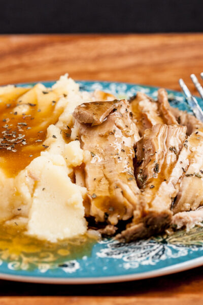 Slow Cooker Pork Loin with Mashed Potatoes on a plate with fork