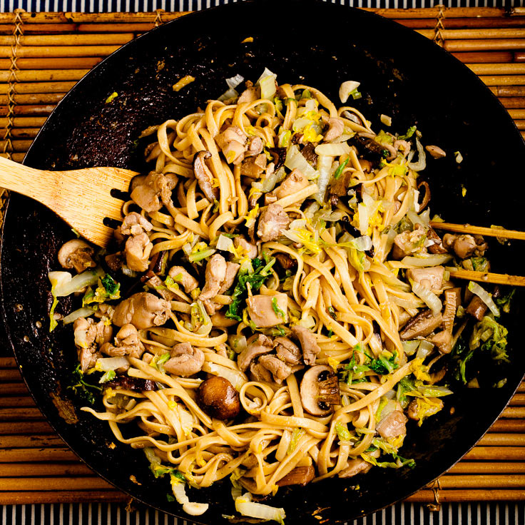 Chicken lo mein with napa cabbage in wok