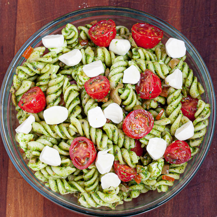 caprese pasta salad with tomatoes and mozzarella in a bowl