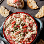 imitation crab dip in bowl with crackers