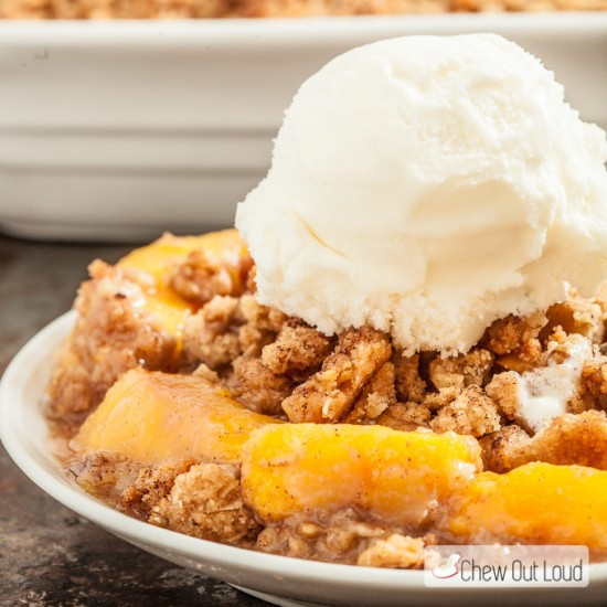 peach crisp with ice cream on plate