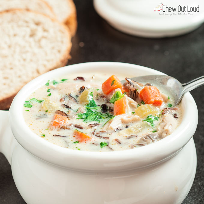 Creamy Chicken Wild Rice Soup in white bowl with spoon