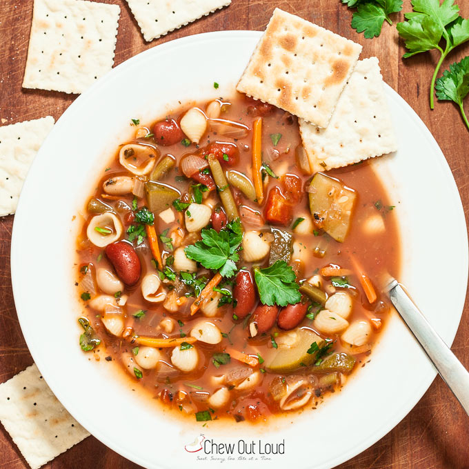 Healthy Minestrone Soup in white bowl with crackers