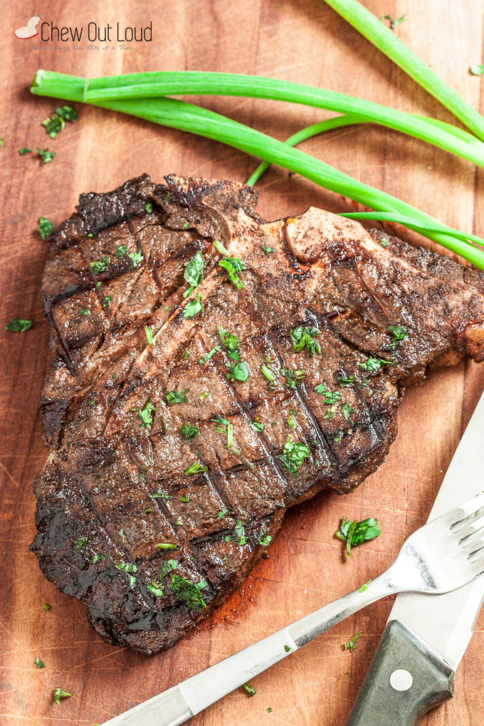 grilled ribeye steak on cutting board