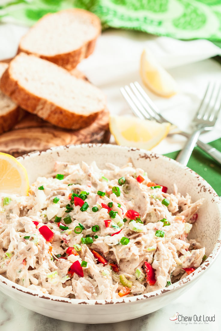rotisserie chicken salad in a bowl with bread slices