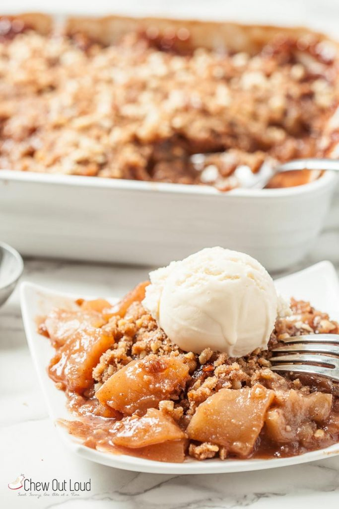Apple crumble on a plate with ice cream