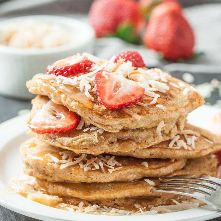 coconut pancakes with strawberries and shredded coconut