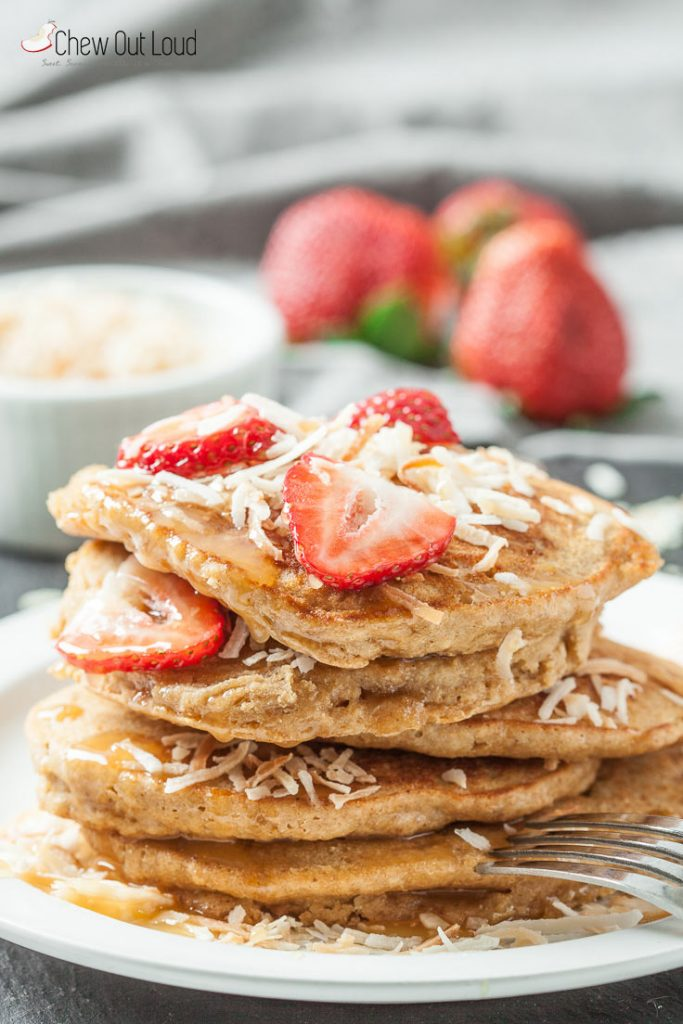 fluffy coconut pancakes with strawberries and toasted coconut