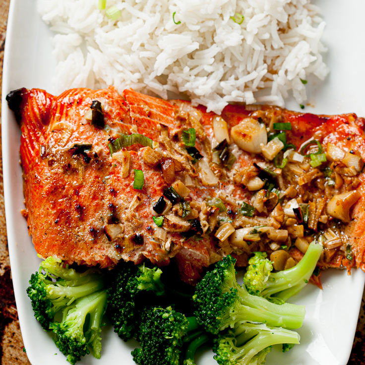 baked salmon with sesame ginger on plate with rice and broccoli