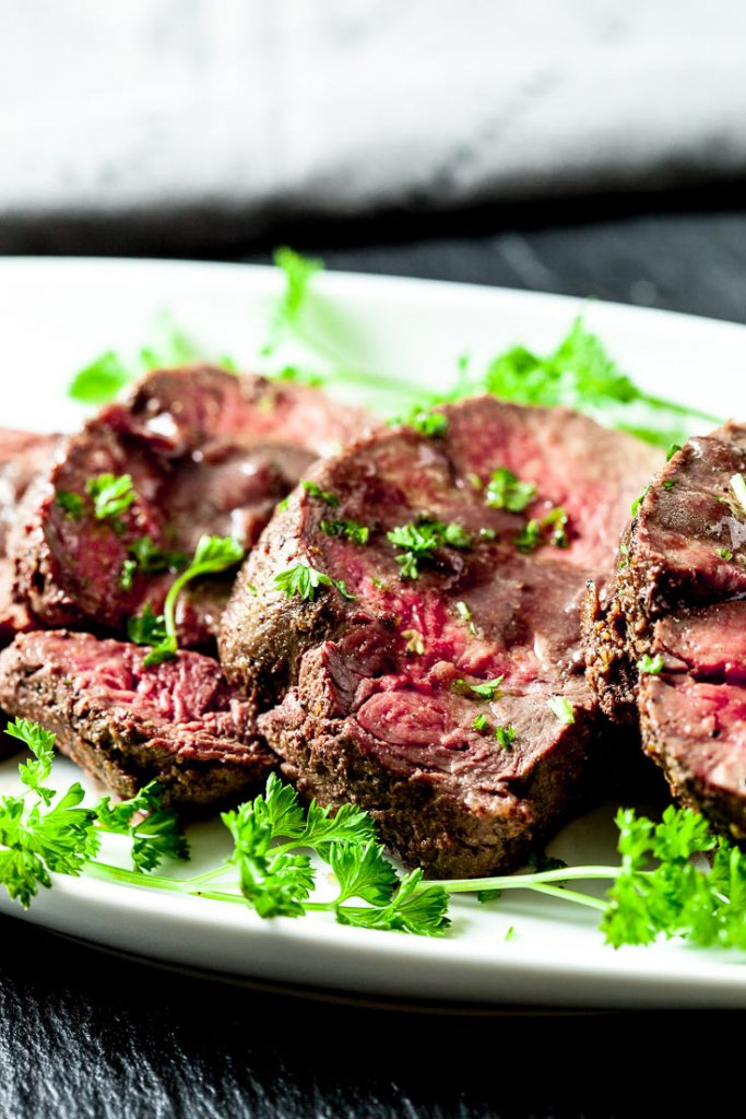 beef tenderloin roast on white plate