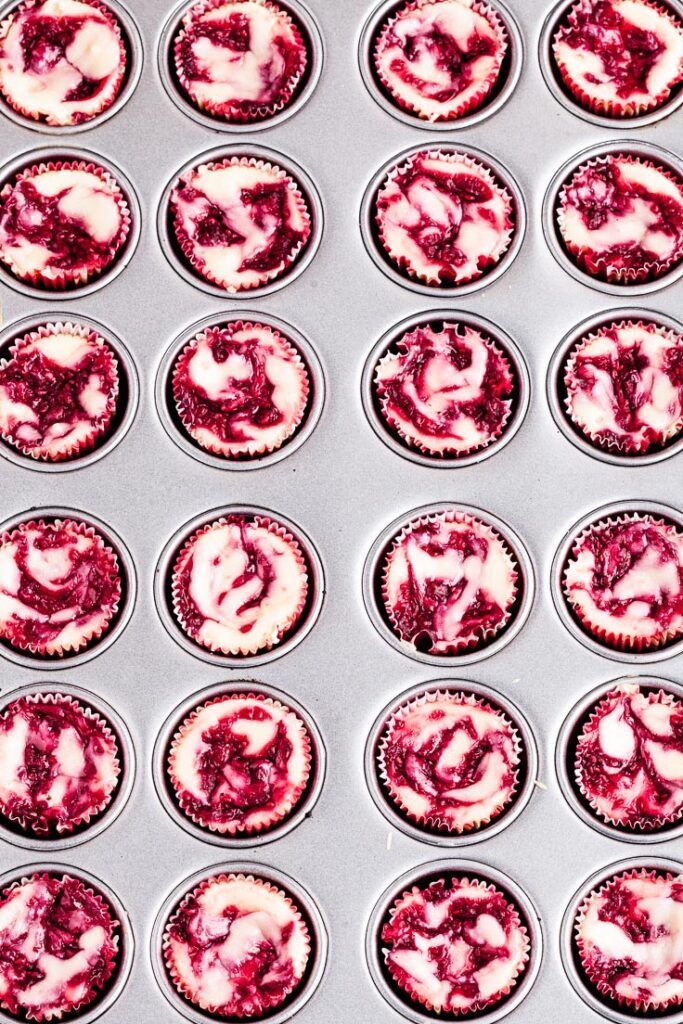 mini white chocolate raspberry cheesecakes in pan