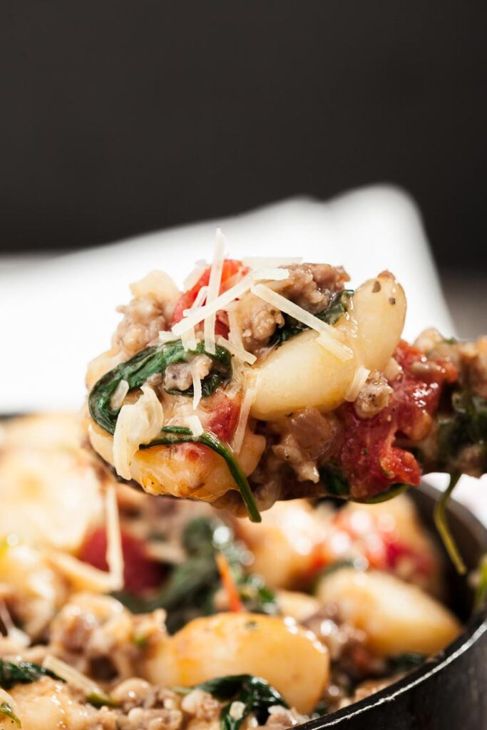 Gnocchi with sausage, spinach, and tomatoes