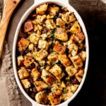 Homemade Stuffing with Sausage and Apples in White Dish Square