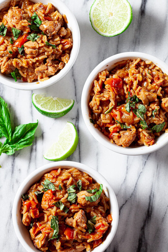 Thai chicken and rice in white bowls
