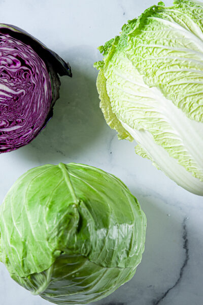 napa cabbage, red cabbage, and green cabbage