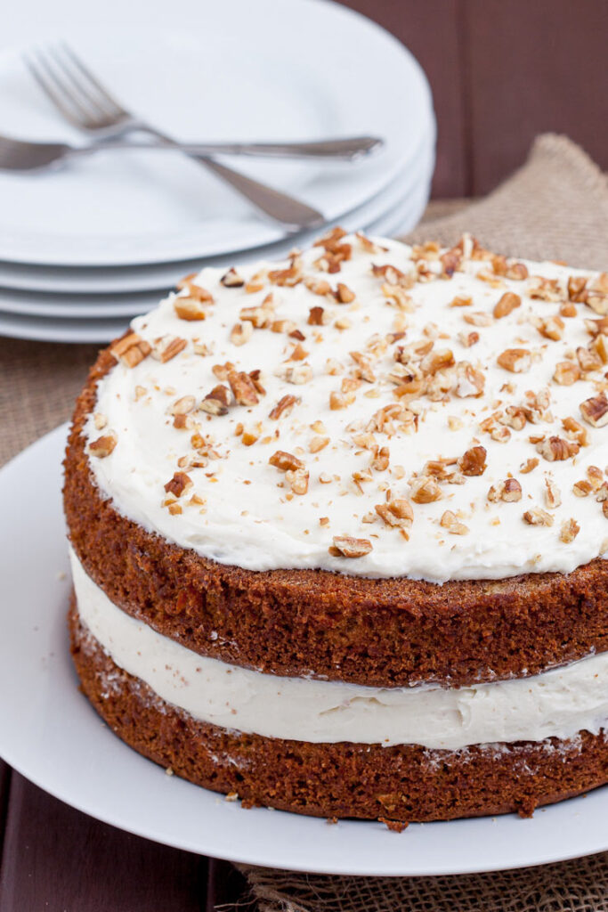 Carrot Cake With Cream Cheese Frosting with plates and fork