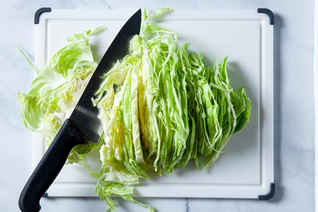 Slice cabbage thinly for stir fry
