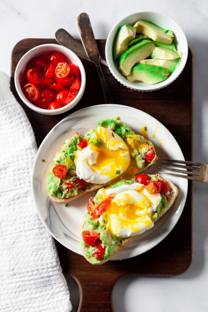 Poached Eggs on Avocado Toast on plate