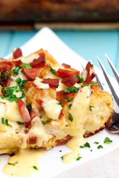eggs benedict casserole slice close up square