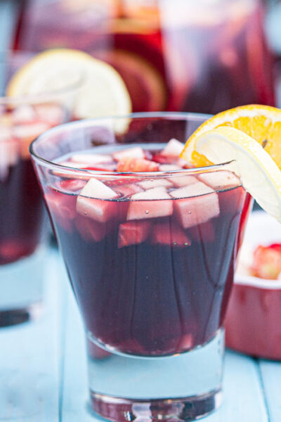 red sangria in glasses with fresh fruits