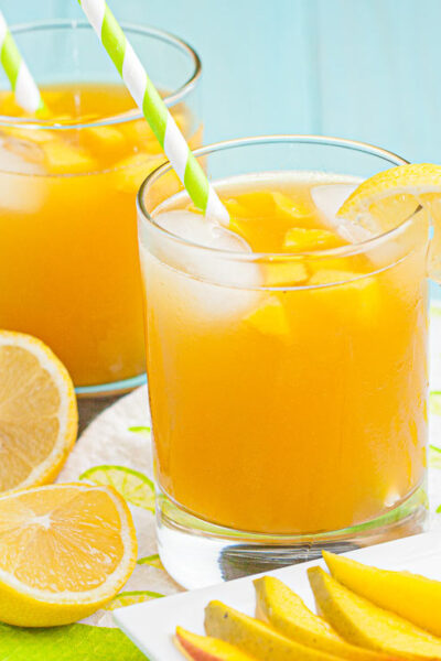 mango cocktails in glasses with ice